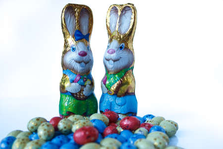 Two chocolate easter bunnies and chocolate easter eggs