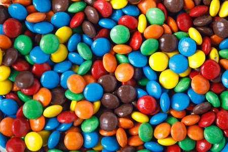 Various colored smarties as a background