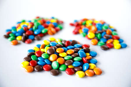 Three piles of colored smarties Stock Photo