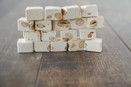 A wall of nut nougat bar traditional sweet candy