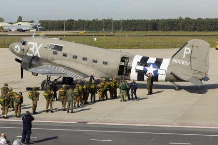 Eindhoven Netherlands sept. 20. 2019: Reenactors and veteran paratroopers enter a C-47 to jump at the Market Garden memorial. Editorial