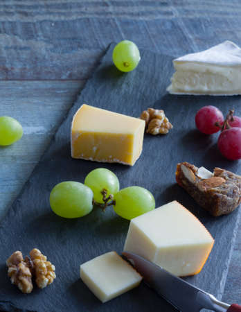 Cheese platter witch assorted cheese and grapes