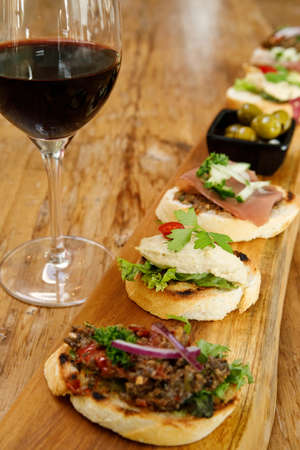 Canape or crostini with toasted baguette and various spreads