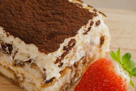 Tiramisu. Traditional italian dessert on wooden plate.