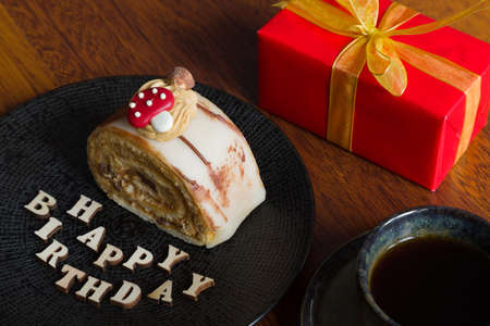 Beautiful and delicious pastry with a birthday gift Standard-Bild