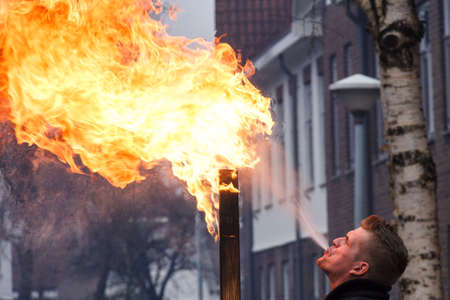 Kampen, The Netherlands Dec 31 2016 Man spitting fire during new years eve Editorial