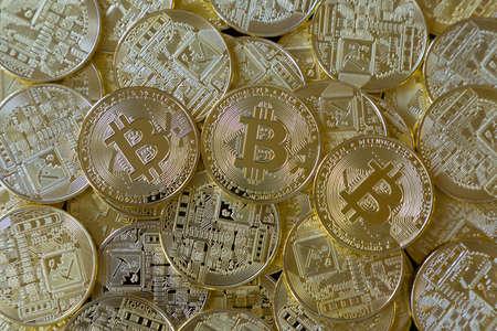 A heap of many golden bitcoins. Cryptocurrency concept