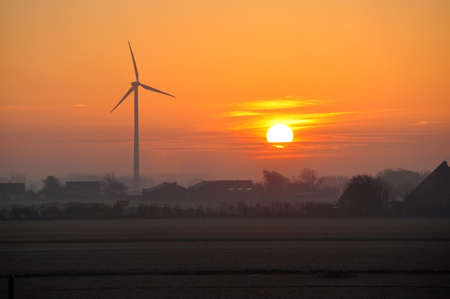 Dutch windmills at winter sunrise photo