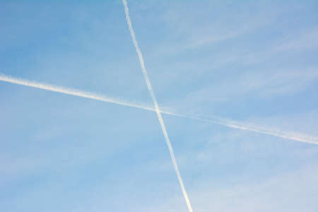 contrails in the blue sky photo