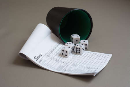 dice and cup on grey background photo