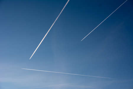 pollution free: contrails in the blue sky