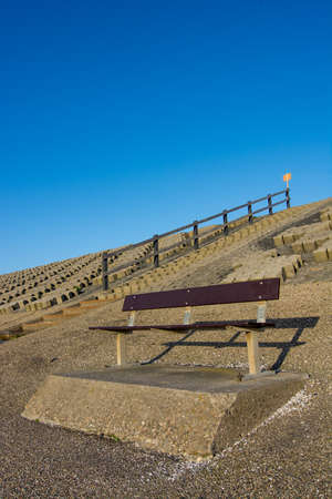 wooden bench at the beach photo