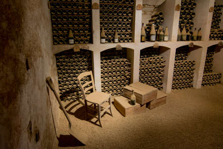 wine cellar with old wine bottles