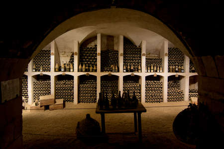 wine cellar with old wine bottles photo