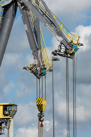 chiming: large crane at industrial site
