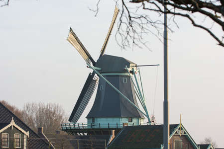 sunset with an old Dutch windmill photo