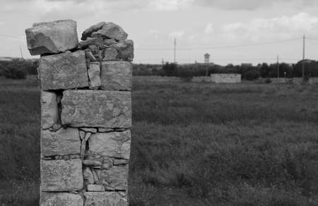 ancient stone column in lands Imagens
