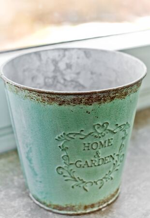 A turquoise Decoration Bucket with Home & Garden inscription Stock fotó - 133441995