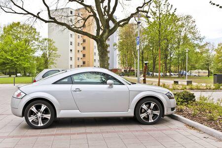 A sporty silver car parked on a parking lot. Leherheide Bremerhaven, Germany.