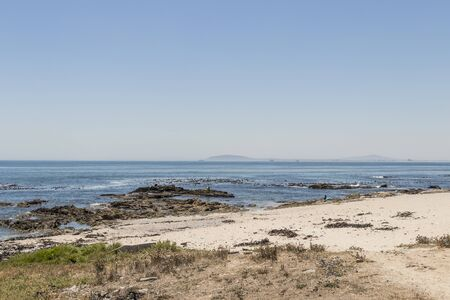 View on Robben Island seen from the Sea Point Promenade in Cape Town, South Africa.