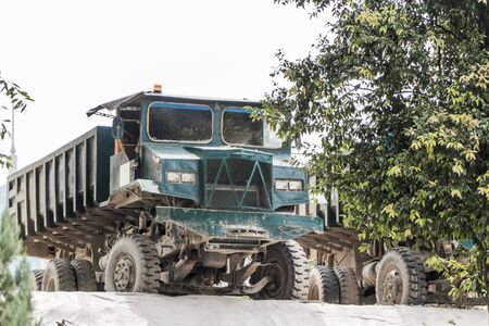 Large old dark blue turquoise dump truck tipper from Malaysia, Asia.