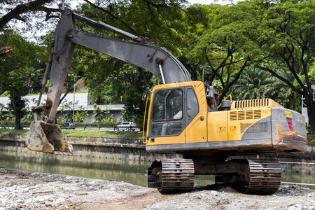 An excavator in tropical nature of Malaysia. 스톡 콘텐츠