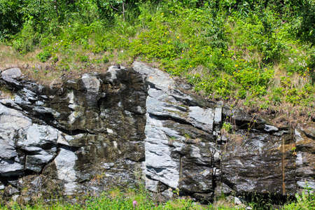 Wet rocks from the rain melt water in Hemsedal, Viken, Norway.