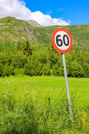 60s zone 60 road sign around red in Norway.