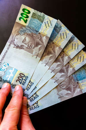 Be rich with money in Brazil. 200 Brazilian banknotes Reaís Real R $ BRL.
