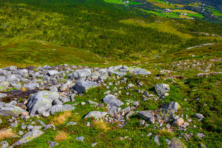 Amazing norwegian landscape with boulders at the summit on the mountain top in Vang i Valdres Norway.