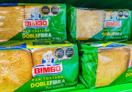Playa del Carmen Mexico April 23, 2021 Bimbo toasted white bread Pan Tostado Doble Fibra packaging in the supermarket in Playa del Carmen Mexico.