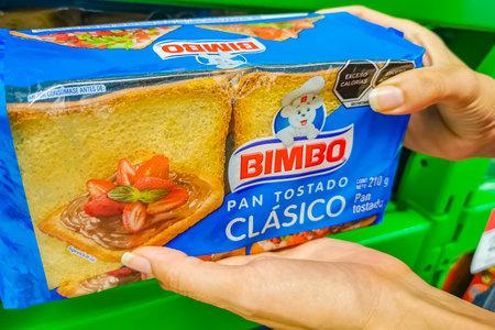 Playa del Carmen Mexico April 23, 2021 Bimbo toasted white bread Pan Tostado Clasico classic packaging in the supermarket in Playa del Carmen Mexico. Editorial