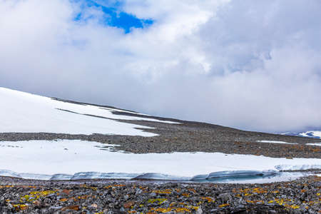Galdhøpiggen snow-covered in summer in Jotunheimen Lom in Norway is the largest and highest mountain in Norway and Scandinavia with 2469 meters. Stock fotó