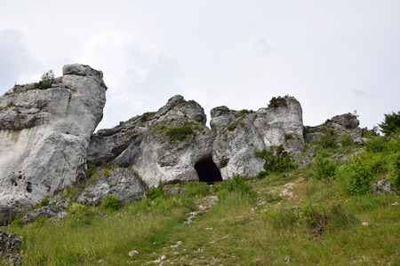 Cave entrance and rock formation in Krakow Czestochowa Upload. Polish Jurassic Highland.