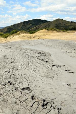 Dry, cracked earth near Mud Volcanoes (Vulcanii Noroiosi) in Berca. Buzau, Romania. Stock Photo