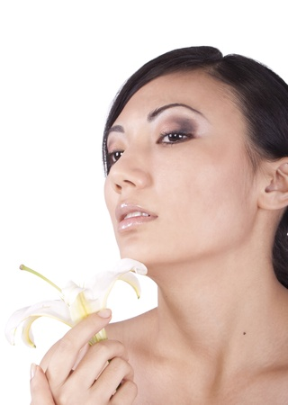 Portrait of a girl, with a lily on a white background. Brunette photo
