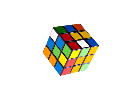 Rubik's cube on a white background, multicolored cube.