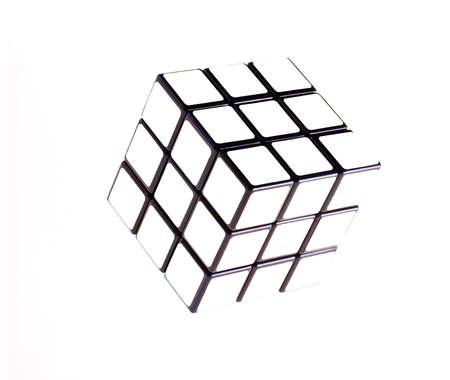 Rubiks cube on a white background, white cube with black faces. Stock Photo