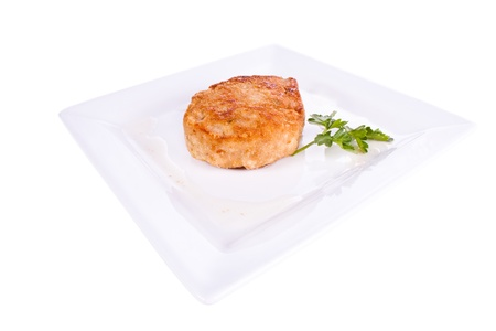 Chop in breadcrumbs. on a plate. on a white background. photo