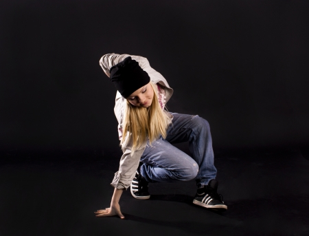 only teenage girls: Modern dance, hip hop girl dancer on a black background.
