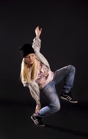 Modern dance, hip hop girl dancer on a black background. Stock Photo - 9528475