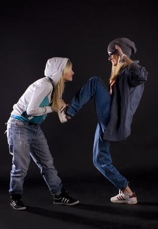 one girl only: Modern dance, hip hop girl dancer on a black background.
