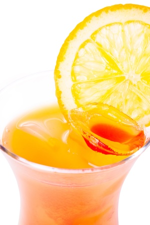 Tequila with orange and ice on a white background. Orange cocktail.
