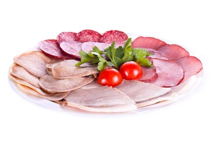Splitting of sausages and meat dishes with tomatoes. On a white background. photo