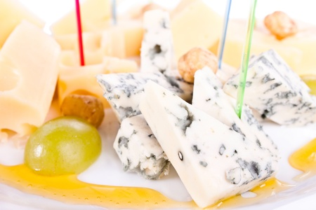 Plate with three kinds of cheese on skewers. And grapes. Stock Photo - 9556106