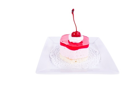 Cake with cherry jam, jelly on a plate. Shallow depth of field. photo