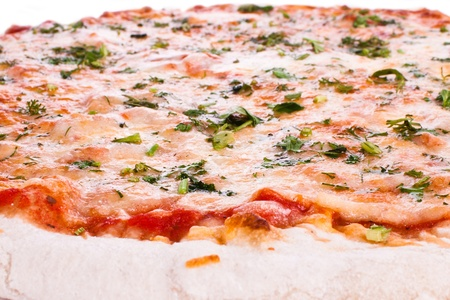 Cheese pizza, topped with greens. On a white background. photo