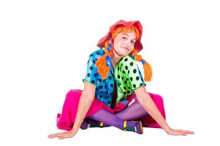 A girl dressed as a clown red. White background. Studio photography.