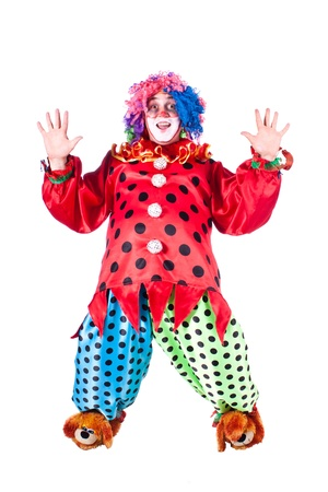Man dressed as clown red. White background.  photo