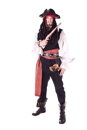 A man dressed as a pirate, pistol and saber. White background. Studio photography.